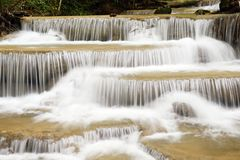 Beautiful waterfall in green forest Stock Photos