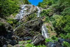 Beautiful waterfall in the green forest. Great waterfall in Thailand royalty free stock photo