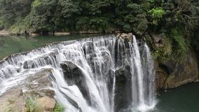 Beautiful waterfall at the green forest. In Taiwan stock footage