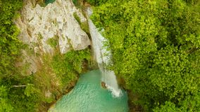 Beautiful waterfall in green forest, top view. Tropical Inambakan Falls in mountain jungle, Philippines, Cebu. Waterfall. In the tropical forest. Pure water in stock video footage