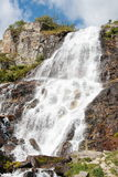 Beautiful waterfall in the Italian mountains Alps.  Royalty Free Stock Image