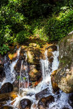 Beautiful waterfall in the jungle at sunny day Royalty Free Stock Images