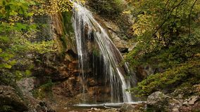 Beautiful waterfall Jur-Jur in the autumn forest. Natural sights of the Crimea stock footage