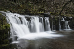 Beautiful waterfall landscape image in forest during Autumn Fall stock photography