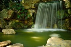 The beautiful waterfall looks like silk In a park in guangzhou, China stock images