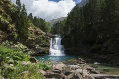 Waterfall in the forest of `Cola de Caballo` in Aragon, Spain. A beautiful waterfall in the middle of the forest of `Cola de Caballo stock images
