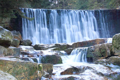 Beautiful waterfall on a mountain slope. River with cascades Royalty Free Stock Images