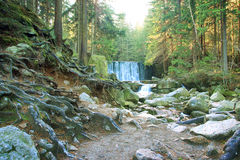 Beautiful waterfall on a mountain slope. River with cascades Stock Image