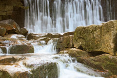 Beautiful waterfall on a mountain slope. River with cascades Royalty Free Stock Image