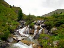 Beautiful Waterfall from the Mountains . The short Waterfall in Samnaun stock photo