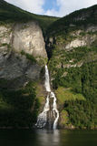 A beautiful waterfall in Norway. Hidden in a mountaneous landscape Royalty Free Stock Photos