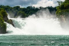 A beautiful waterfall on the river Rhine in the city Neuhausen am Rheinfall in northern Switzerland. The Rhine Falls is the larges. T waterfall in Europe royalty free stock photos