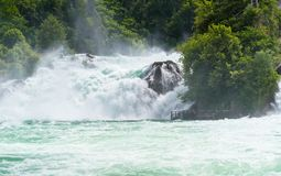 A beautiful waterfall on the river Rhine in the city Neuhausen am Rheinfall in northern Switzerland. The Rhine Falls is the larges. T waterfall in Europe stock photos