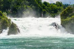 A beautiful waterfall on the river Rhine in the city Neuhausen am Rheinfall in northern Switzerland. The Rhine Falls is the larges. T waterfall in Europe stock images