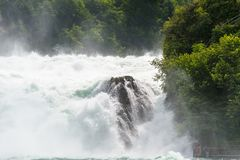 A beautiful waterfall on the river Rhine in the city Neuhausen am Rheinfall in northern Switzerland. The Rhine Falls is the larges. T waterfall in Europe royalty free stock photo