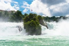 A beautiful waterfall on the river Rhine in the city Neuhausen am Rheinfall in northern Switzerland. The Rhine Falls is the larges. T waterfall in Europe royalty free stock photography