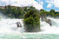A beautiful waterfall on the river Rhine in the city Neuhausen am Rheinfall in northern Switzerland. The Rhine Falls is the larges. T waterfall in Europe stock image