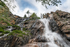 Beautiful waterfall at the rocks in Altai mountains Royalty Free Stock Photo