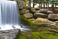 Beautiful waterfall in rocky park in fall Stock Image