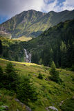 Beautiful waterfall in the scenery of green mountains in Romania.  royalty free stock image