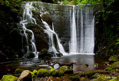 A beautiful waterfall in a Scottish Glen. Perfect place for you to escape Stock Images