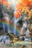 Beautiful waterfall with soft focus and rainbow in the forest. Beautiful waterfall with soft focus mountains and rainbow in the forest Royalty Free Stock Photos