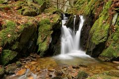 Beautiful waterfall on stream Royalty Free Stock Image