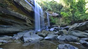 Beautiful waterfall on sunny day. Thailand stock footage