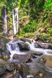 Beautiful waterfall in the tropical rainfores. Waterfall in the tropical rainforest in thailand Stock Image