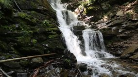 Beautiful waterfall, water flows over rocks. Beautiful waterfall. Water flows over the rocks stock video