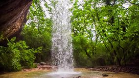 Beautiful Waterfall In Wild Crimea Forest. Beautiful scenic view of one of the most beautiful waterfall called Kozyrek (Kobalar) falling off the rock into the stock footage