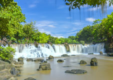 Beautiful waterfalls in Ecotourism. With water flowing smooth as silk attract tourists to visit on a sunny summer day on weekends Stock Photography