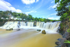 Beautiful waterfalls in Ecotourism. With water flowing smooth as silk attract tourists to visit on a sunny summer day on weekends Stock Images