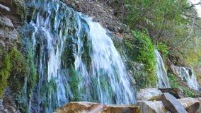 Beautiful waterfalls falling down. Slavonic springs, Izborsk.