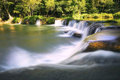 Beautiful waterfalls in pure deep forest of thailand national pa Stock Images