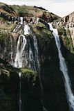 Beautiful waterfalls on rocks and green vegetation. In iceland stock photos