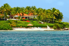 Beautiful waterfront home with beach on Antigua Royalty Free Stock Photo