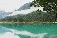 Beautiful waterscape on lake Jagersee on a foggy sommersday. Beautiful waterscape with reflection on lake Jagersee on a foggy sommersday, Kleinarl, Salzburg stock photography