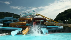 Beautiful waterslide landscape people having fun. Group of people going to vacation at pool where they are a lot of waterslides and pools, attractions and stock video