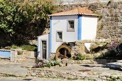 Beautiful waterwheel in Azenhas do Mar in Portugal. Azenhas do Mar, Sintra, Lisbon, Portugal- March 19, 2019: Beautiful and colorful waterwheel in Azenhas do Mar royalty free stock images