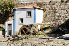 Beautiful waterwheel in Azenhas do Mar in Portugal. Azenhas do Mar, Sintra, Lisbon, Portugal- March 19, 2019: Beautiful and colorful waterwheel in Azenhas do Mar stock image