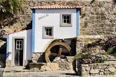 Beautiful waterwheel in Azenhas do Mar in Portugal. Azenhas do Mar, Sintra, Lisbon, Portugal- March 19, 2019: Beautiful and colorful waterwheel in Azenhas do Mar stock images