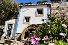 Beautiful waterwheel in Azenhas do Mar in Portugal. Azenhas do Mar, Sintra, Lisbon, Portugal- March 19, 2019: Beautiful and colorful waterwheel in Azenhas do Mar royalty free stock image