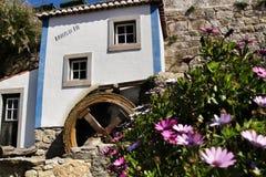 Beautiful waterwheel in Azenhas do Mar in Portugal. Azenhas do Mar, Sintra, Lisbon, Portugal- March 19, 2019: Beautiful and colorful waterwheel in Azenhas do Mar royalty free stock photo