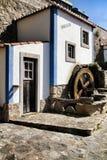 Beautiful waterwheel in Azenhas do Mar in Portugal. Azenhas do Mar, Sintra, Lisbon, Portugal- March 19, 2019: Beautiful and colorful waterwheel in Azenhas do Mar stock photos