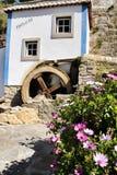 Beautiful waterwheel in Azenhas do Mar in Portugal. Azenhas do Mar, Sintra, Lisbon, Portugal- March 19, 2019: Beautiful and colorful waterwheel in Azenhas do Mar stock photo