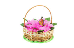 Beautiful wattled basket with artificial flowers Stock Photo