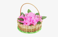 Beautiful wattled basket with artificial flowers Royalty Free Stock Image