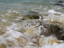 Beautiful wave breaks to the shore and it called swash. Crystal clear water on the shore beach stock photos