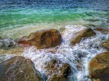 Beautiful wave breaks to the shore and it called swash. Crystal clear water on the shore beach stock photo